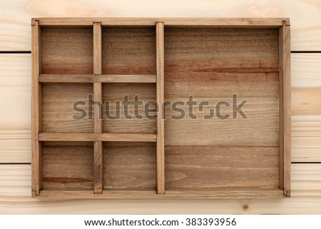 Empty wooden box with wood background - stock photo