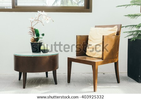 Empty wooden chair with pillow decoration in living room interior - Vintage Filter