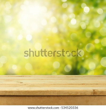 spring leaf table empty wooden deck table foliage bokeh stock photo 127267235