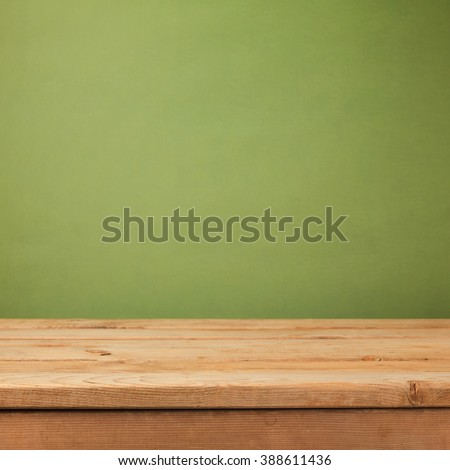 Empty wooden deck table over green wallpaper background. Mock up for product advertise - stock photo