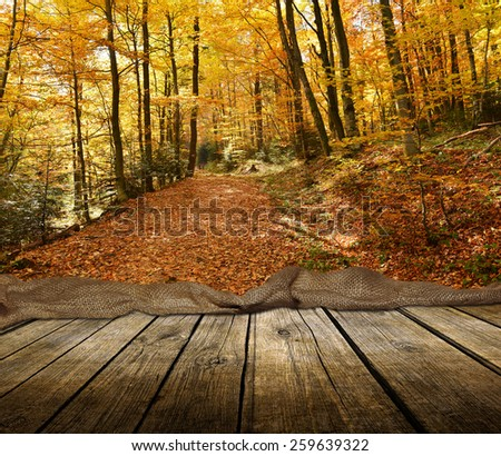 Empty wooden deck table with autumn background. Ready for product display montage.  - stock photo