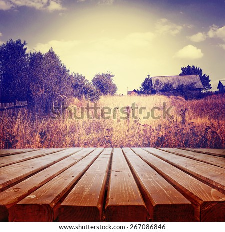 Empty wooden deck table with scenery background. Ready for product display montage.   - stock photo