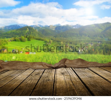 Empty wooden deck table with summer background. Ready for product display montage.  - stock photo