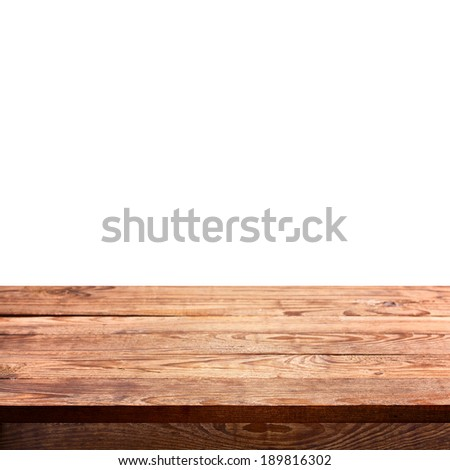 Empty wooden deck table with tablecloth for product montage. Free space for your text - stock photo