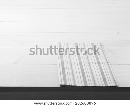 Empty wooden deck table with tablecloth for product montage. Kitchen interiors. Flat mock up for design. Black and White