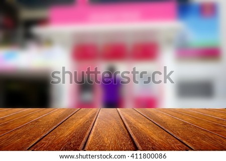 empty wooden for advertising board on blurred customer withdraw or deposit money on atm machine   - stock photo