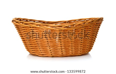 Empty wooden fruit or bread basket on white background - stock photo