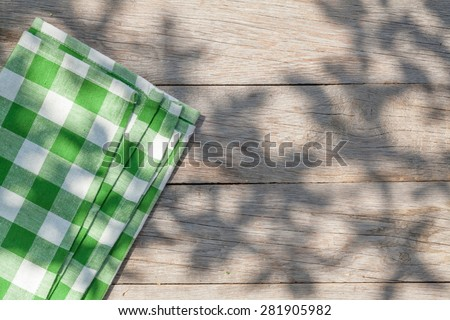 Empty wooden garden table with tablecloth. Top view with copy space - stock photo