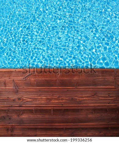 Empty wooden mole with swimming pool, shot from top view - stock photo