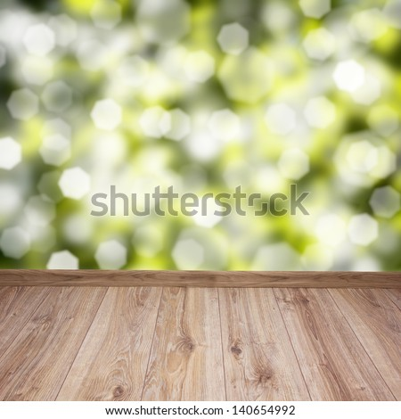 empty wooden planks with green leaves bokeh background - stock photo