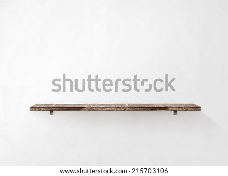 Empty wooden shelf on the wall - stock photo
