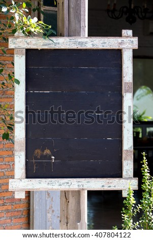 Empty wooden signboard in the garden Thailand