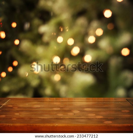 Empty wooden table against christmas  background - stock photo