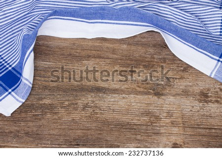 empty wooden table   and cloth blue napkin - stock photo