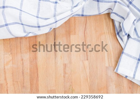 empty wooden table and cloth white and blue napkin - stock photo