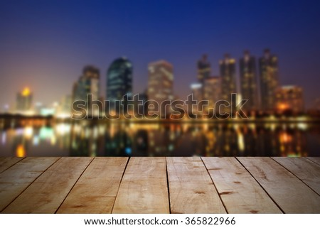 Empty wooden table at night city landscape. Can put your products for display. - stock photo