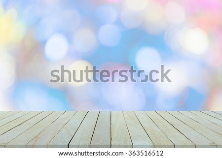 Empty wooden table or shelf wall on colorful bokeh background, For present your products. - stock photo