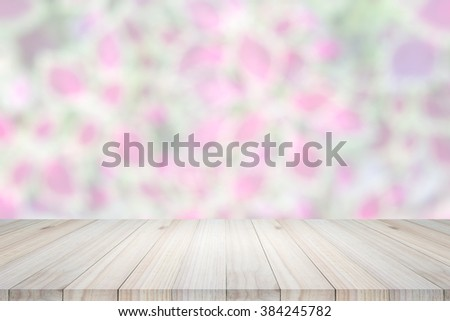 Empty  wooden table or shelf wall on colorful bokeh background. For present your products.  - stock photo