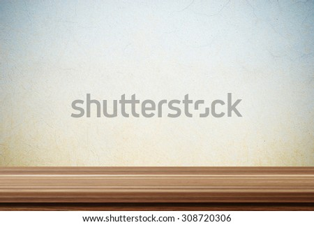 Empty wooden table over grunge cement wall, vintage, background, template, product display