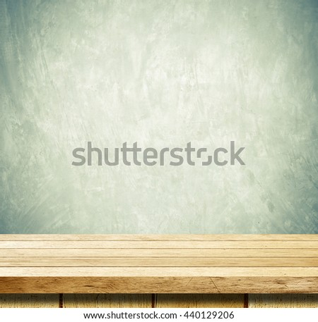 Empty wooden table over grunge cement wall, vintage, background, template, product display montage