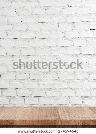 Empty wooden table over white brick wall background, Product display, template