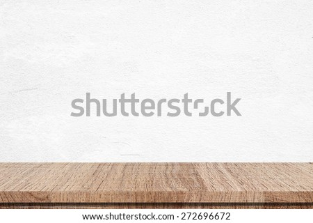 Empty wooden table over white cement wall, vintage, background, template, display - stock photo