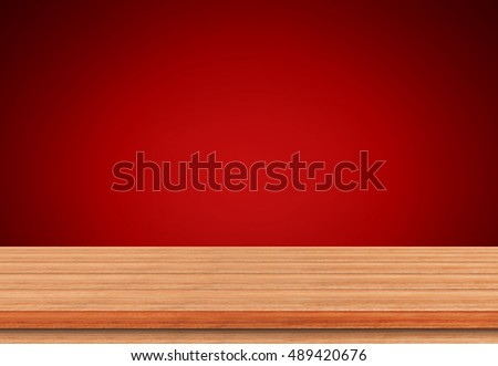 Empty wooden table top on red background, Use as montage for product display.