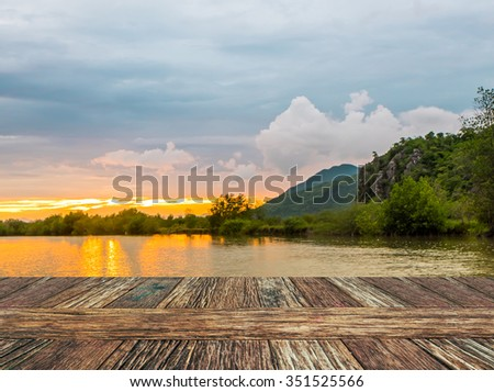 Empty wooden table  with river and muontain natural bokeh background. Product display template. - stock photo