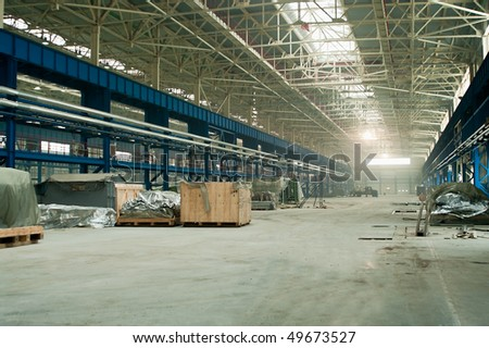 Empty works in factory. Storage area in new shop - stock photo