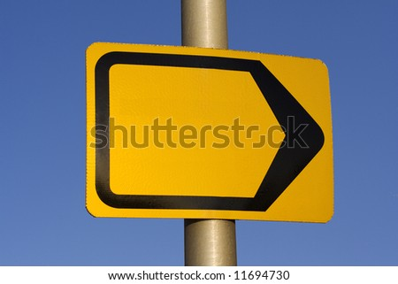 Empty yellow direction sign. Add your own text or logo - stock photo