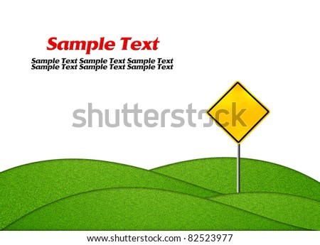 Empty yellow warning road sign with green grass isolated on white - stock photo