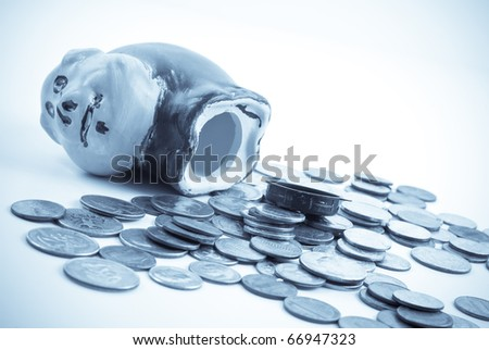 Emptying Out the Piggy Bank - stock photo
