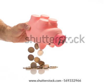 emptying piggy bank with euro, isolated on white