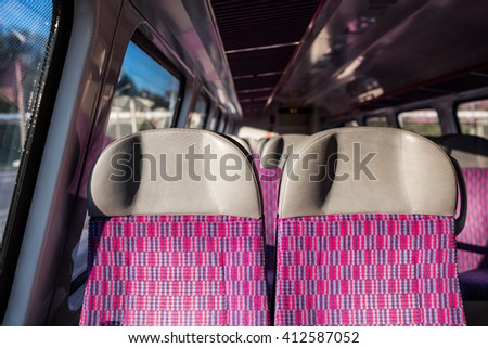 Emtpy interior of the train for long and short distance in Europe. salon of high speed train at a railway station - stock photo