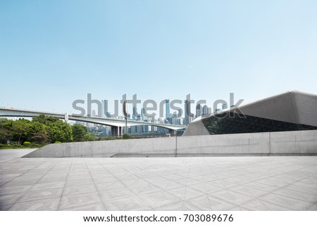 emtpy marble floor with cityscape of chongqing in blue sky