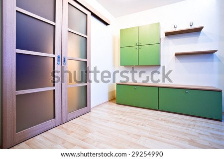 Emty hall with doors and green bookcases - stock photo