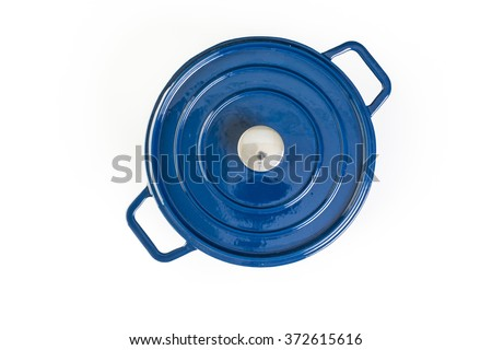 Enameled blue cast iron covered dutch oven on a white background. - stock photo
