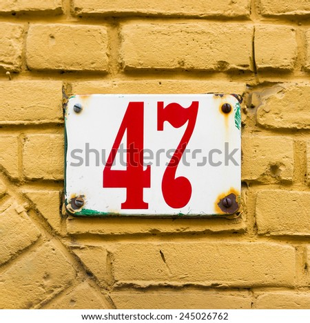 enameled house number forty seven - stock photo