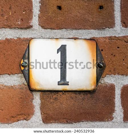 enameled house number one. - stock photo