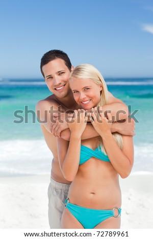 Enamored couple on the beach - stock photo