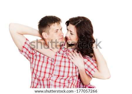 Enamoured young man and woman looking at each other. - stock photo