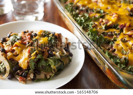 Enchilada Casserole with Kale and Sweet Potatoes, vegetarian dinner casserole - stock photo