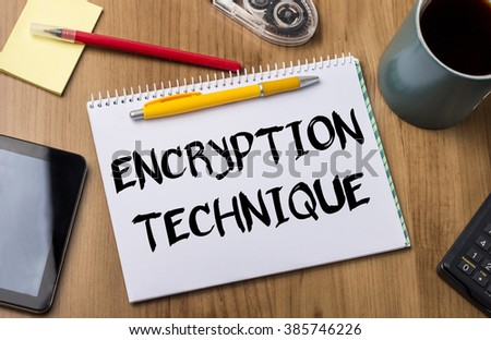 ENCRYPTION TECHNIQUE - Note Pad With Text On Wooden Table - with office  tools - stock photo