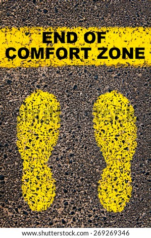 End of Comfort Zone message. Conceptual image with yellow paint footsteps on the road in front of horizontal line over asphalt stone background. - stock photo