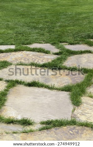 End of flagstone path to green lawn