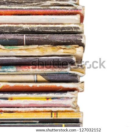 End of pile of old magazines isolated on white background - stock photo