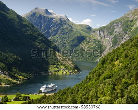 End of the famous Geiranger fjord, Norway with cruise ship - stock photo