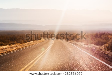 endless asphalt road with blue sky in Big Bend National Park, Texas, USA - stock photo