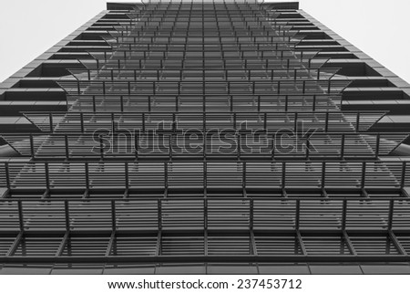 Endless line of windows on an office building, upward angle - stock photo