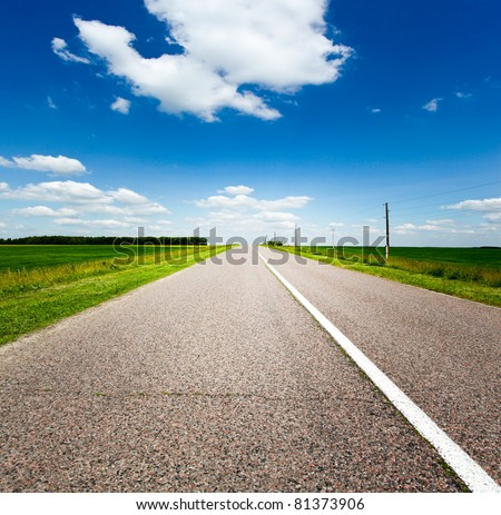 endless rural road and blue cloudy sky - stock photo
